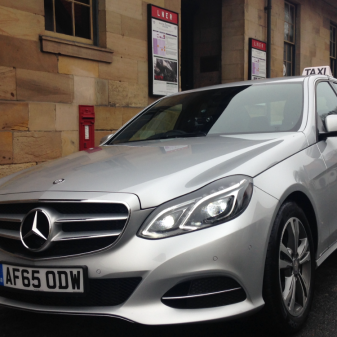 Mercedes E-Class at Pickering Train Station